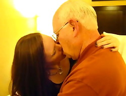 Young beautiful girl smooches with thick old man