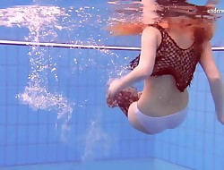 Matrosova steamy ginger pussy in the pool